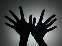Two hands silhouette Stock Photos