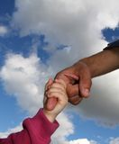 Two hands on the sky. Father and daughter hands - love parent Stock Image