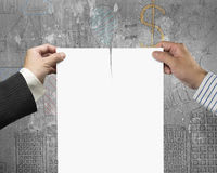 Two hands tearing contract paper with blank Royalty Free Stock Images