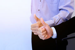 Two hands thumb up for business background. Stock Photos