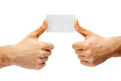 Two hands with thumb up holding a white plastic card Stock Images