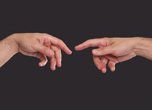 Two hands about to touch. Like in the creation Stock Photo