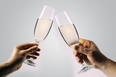 Two hands toasting champagne stock photography