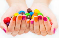 Two hands together holding candies Royalty Free Stock Image