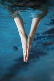 two hands together surfaced from water, V - shape  Royalty Free Stock Photos