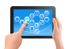Two hands touch screen of tablet with medical icon Stock Image