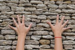 Two hands touched a stone wall royalty free stock photo