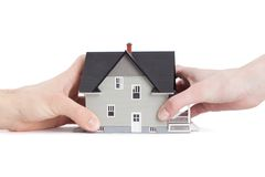 Two hands trying to divide house, isolated. Real estate concept - two hands trying to divide house, isolated stock photos