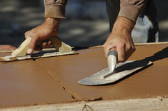 Two Hands, Two Trowels! Stock Photo