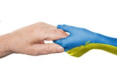 Two hands and Ukrainian flag Stock Images