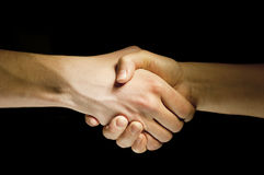 Two hands unite with eachother as agreement Stock Photo