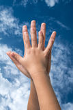 Two hands up to sky Stock Images