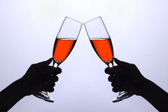 Two hands with wine glasses. Cheers Royalty Free Stock Photography