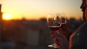 Two Hands and wineglass silhouette on sunset. Drink wine on the roof. Saint Petersburg stock footage
