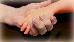 Two hands of young and old. Hand the old lady, holding the hand of a small child Royalty Free Stock Photos