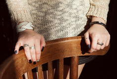 Two hands of young woman on chair Royalty Free Stock Images