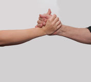Two hands young woman and old man Stock Photo