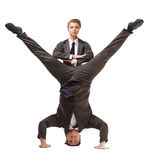 Two handsome acrobats posing in official suits Royalty Free Stock Image