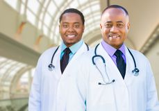 Two African American Male Doctors Inside Hospital Office Stock Image