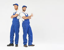 Two handsome builders during the work Royalty Free Stock Photo