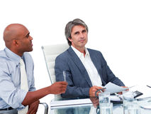 Two handsome businessmen having a meeting Stock Images