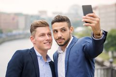 Two handsome businessmen talking a selfie Royalty Free Stock Photography