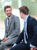 Two handsome businessmen working together on a project in the of Royalty Free Stock Images