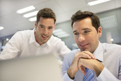 Two handsome businessmen working together on a project in the of Stock Images