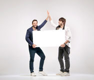 Two handsome friends giving each other a high-five Stock Photography