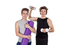 Two handsome guys doing fitness workout with weights isolated on white background royalty free stock photo