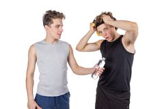 Two handsome guys doing fitness workout with weights isolated on white background stock photo