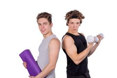 Two handsome guys doing fitness workout with weights isolated on white background stock image