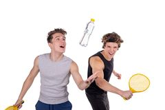 Two handsome guys play tennis isolated on white background stock photos