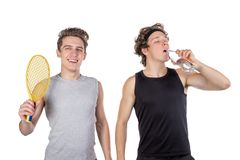 Two handsome guys play tennis isolated on white background stock photography
