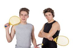 Two handsome guys play tennis isolated on white background stock photo