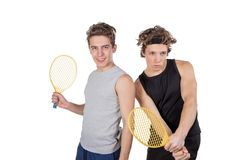 Two handsome guys play tennis isolated on white background stock image