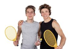 Two handsome guys play tennis isolated on white background stock images