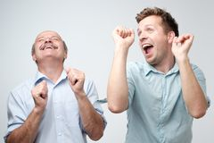 Two handsome male friends dancing on birthday party royalty free stock photography