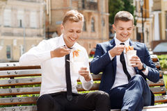 Two handsome men eating Chinese noodles Stock Photos