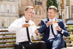 Two handsome men eating Chinese noodles stock photo