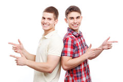 Two handsome men posing on isolated background Stock Images