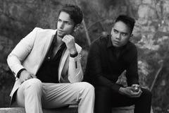 Two handsome men posing outdoor Stock Photo