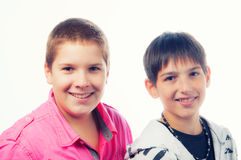 Two handsome teenage boys smiling Stock Images