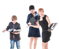 Two handsome women and their boss holding folder with papers. Royalty Free Stock Photography