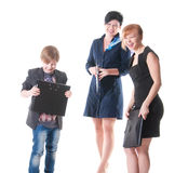 Two handsome women and their boss holding folder with papers. Stock Photography