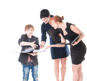 Two handsome women and their boss holding folder with papers. Royalty Free Stock Images
