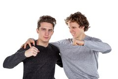 Portrait of two handsome and young furious men fighting with each other on white background royalty free stock image