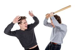 Portrait of two handsome and young furious men fighting with each other on white background stock images