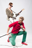 Two handsome young men with guitar and microphone Stock Image