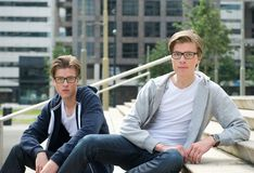 Two handsome young men. Portrait of two handsome young men posing outdoors Stock Photo